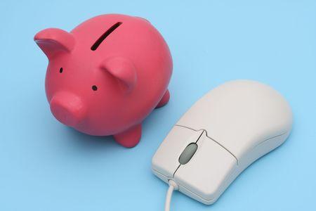 Piggy bank with computer mouse, blue background Zdjęcie Seryjne