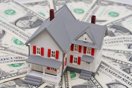 House sitting on dollar bills photo
