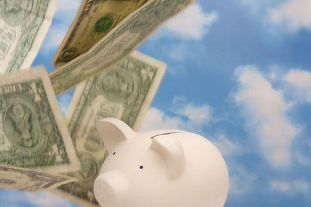 deposit slip: Piggy bank with falling money, sky background