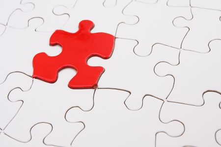 White puzzle with one red piece - use for solution background Stock Photo - 1907752