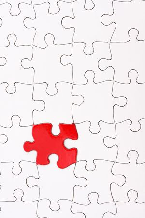 White puzzle with one red piece photo