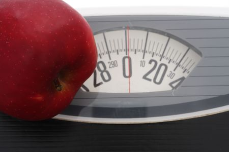 Close up of apple on scales photo