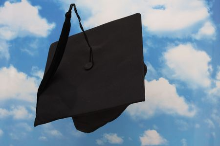 Graduation cap in the being thrown in the air