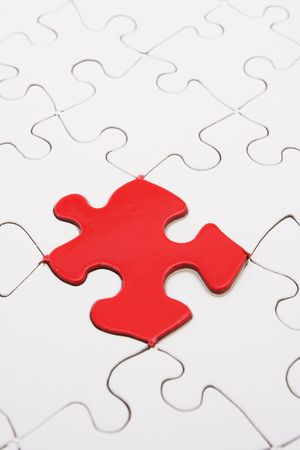 conclude: White puzzle with one bright red piece  Stock Photo