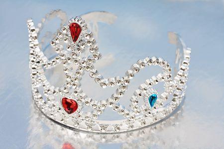 mirrored: Pretty gem tiara on a mirrored background