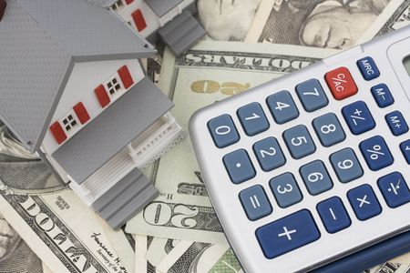 House on American currency and calculator Stock Photo - 1975930