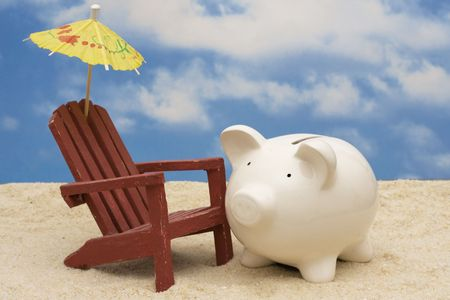 holiday destination: Piggy bank on the beach Stock Photo