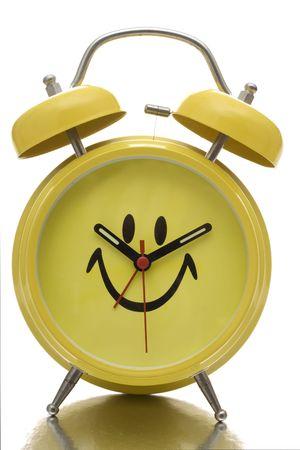 Happy face alarm clock isolated on white background photo