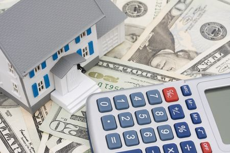 House sitting on American currency and calculator Stock Photo - 1975929
