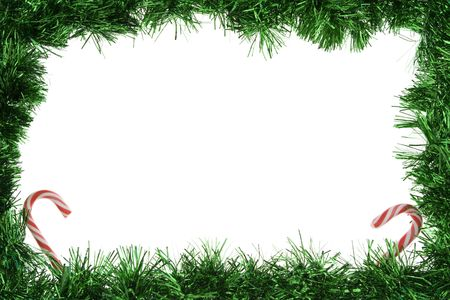 Green garland frame with candy canes photo