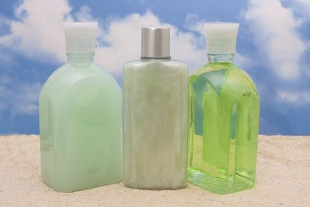 Bottles of moisturizers on beach 版權商用圖片