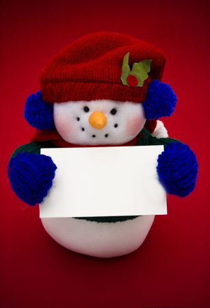 Snowman holding a blank sign for your message photo
