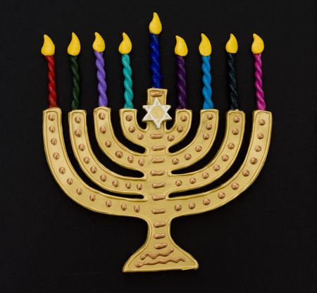 Menorah with colorful candles on a black background photo