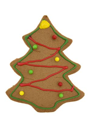 gingerbread cookie: Tree shaped gingerbread cookie isolated on white
