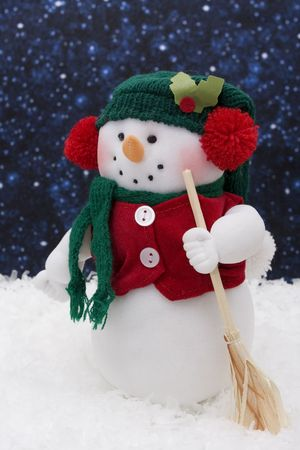 Snowman sitting on snow, night background photo