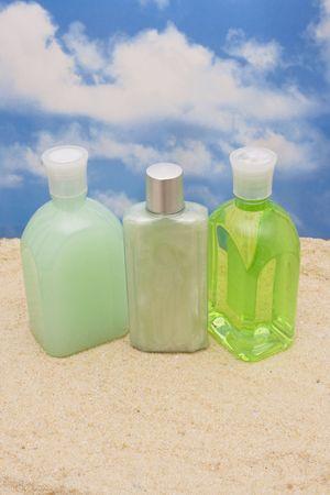 Bottles of moisturizers on beach Stock Photo - 2110294