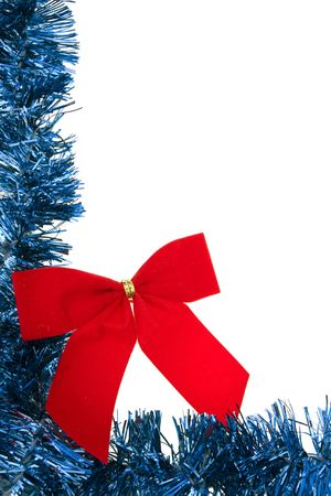 Blue garland border with red velvet bow isolated on white photo