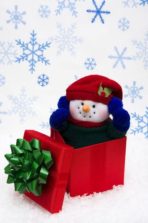 Snowman in gift box with snowflake background Stock Photo - 2154573