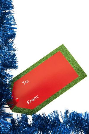 Blue garland border with blank gift tag isolated on white photo