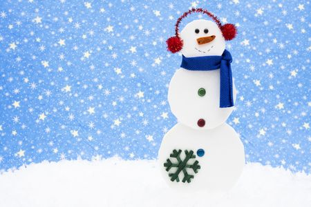 Snowman on snow with a night sky background photo