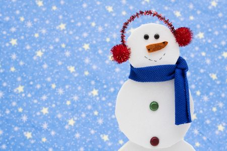Snowman on star background with copy space photo