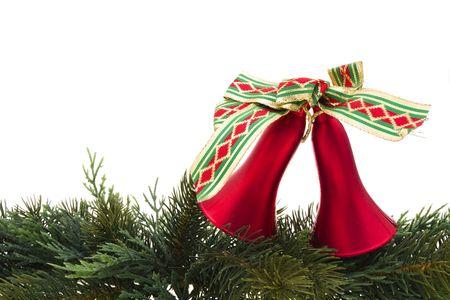 Christmas bells on evergreen garland isokated on white photo