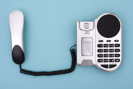 Telephone on blue background with copy space Stock Photo - 2454097
