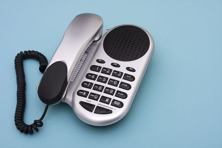 Telephone on blue background with copy space