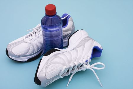 Sneakers with water bottle on blue background Stock Photo - 2454096
