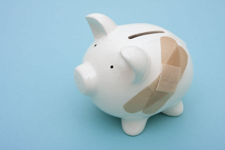 break: Piggy bank with adhesive bandage with copy space Stock Photo