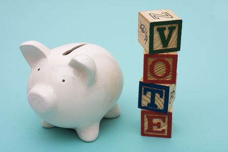 Piggy bank with alphabet blocks spelling vote Stock Photo - 2526005
