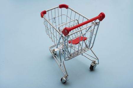 empty shopping cart: Empty Shopping Cart on a light blue background