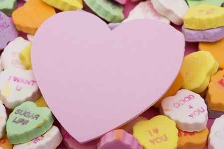 Candy hearts with blank heart in center photo