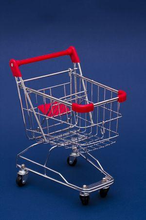 Shopping Cart on a bluebackground Stock Photo - 2526015