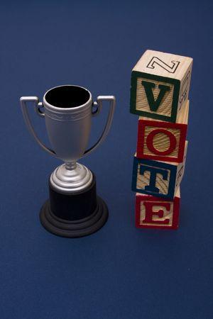Trophy with vote alphabet blocks Stock Photo - 2534034