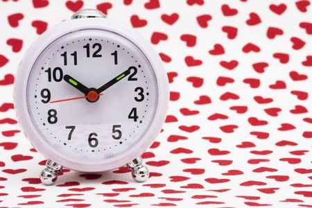Clock on white and heart background Stok Fotoğraf