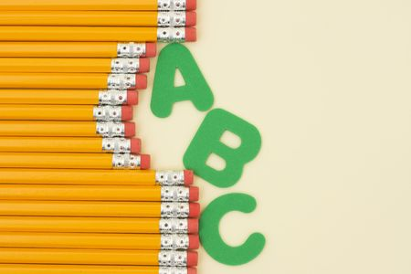 Row of pencils and letters with copy space photo