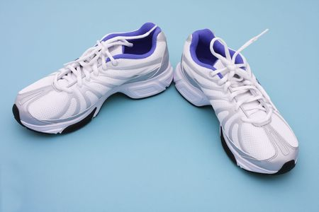 Athletic shoes on blue background with copy space Stockfoto