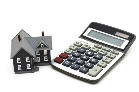 House and calculator isolated on a white background Stock Photo - 2640193