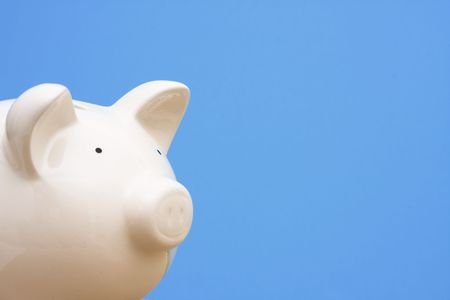 Piggy bank on blue background with copy space Stock Photo - 2649118