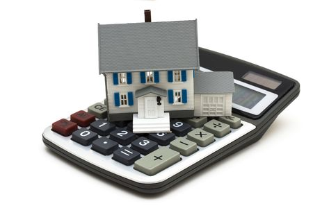 white interest rate: House and calculator isolated on white background Stock Photo