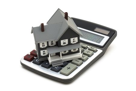 white interest rate: House and calculator isolated on a white background Stock Photo