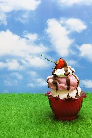 Ice-cream sundae on grass with copy space