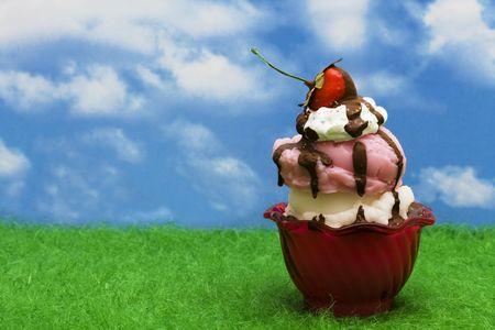 Ice-cream sundae on grass – summertime fun