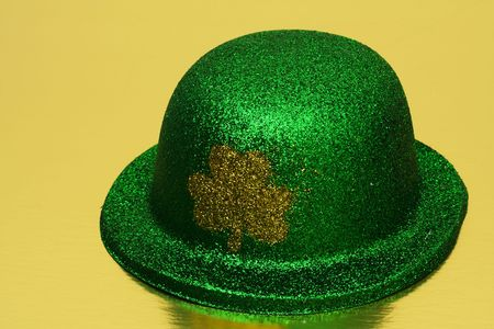 Green hat with shamrock on a gold background Stock Photo - 2731918