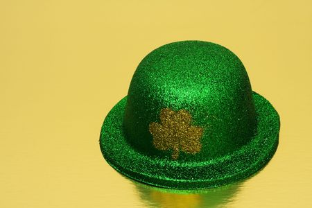 Green hat with shamrock on gold background Stock Photo - 2747013