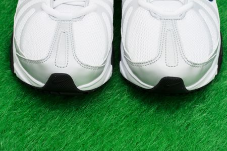 Toe of sneakers on grass – ready for a workout Stock Photo