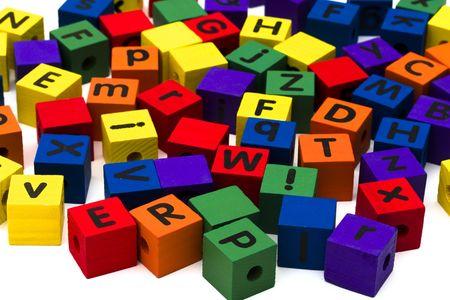 Colourful alphabet blocks on white background photo