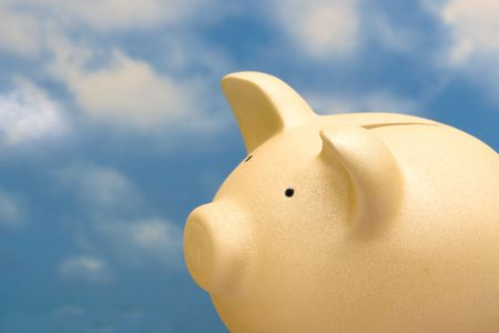 Coin bank sitting on sky background with copy space Stock Photo - 2814392