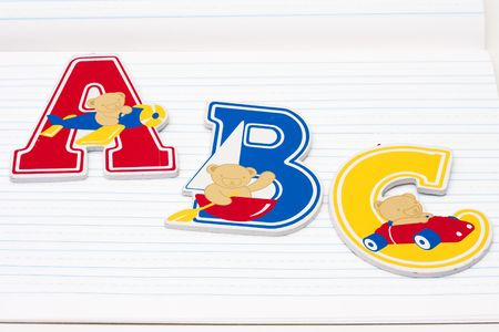 Wooden letters with teddy bears on a scribbler  photo